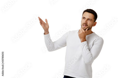 portrait of doubtful bearded man in casual white shirt asking questions isolated on white background Canvas Print