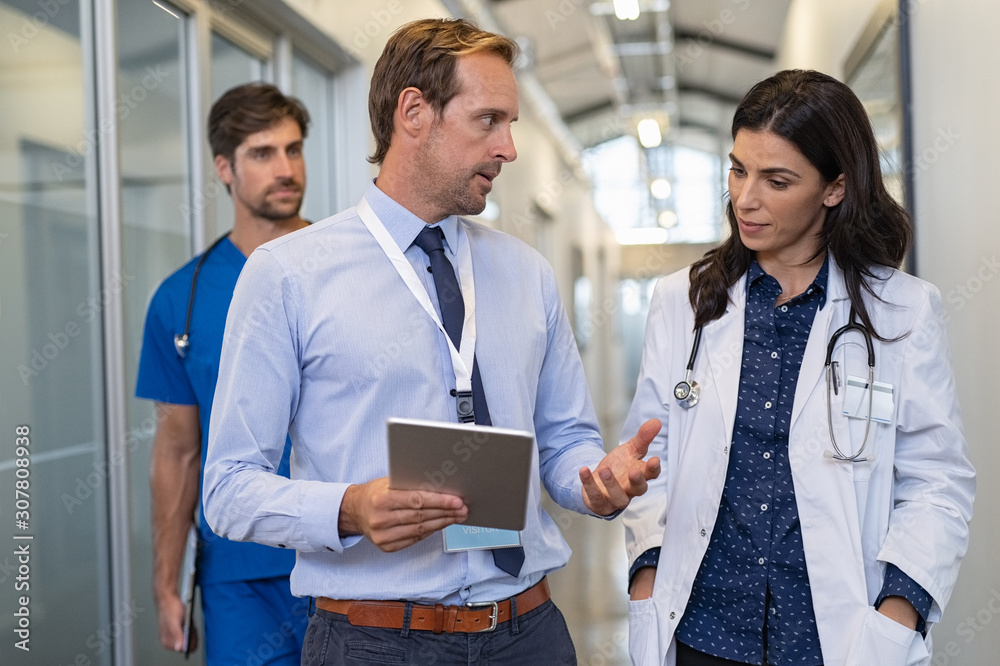 Fototapeta Doctor in a conversation with specialist