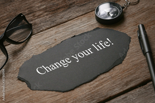 Fototapety, obrazy: Compass,glasses,pen and piece of black paper written with Change Your Life! on wooden background.
