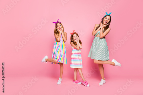 Fototapeta Full size photo of cheerful siblings screaming wow omg touching their faces wearing dress skirt headband isolated over pink background obraz na płótnie