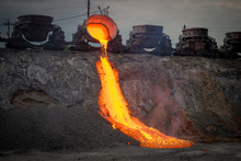 Discharge Of Metallurgical Slag From Blast Furnaces. Beautiful Stream Of Hot Slag