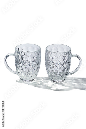 Valokuvatapetti Detailing shot of a pair of dimple pattern beer mugs with large glass handles