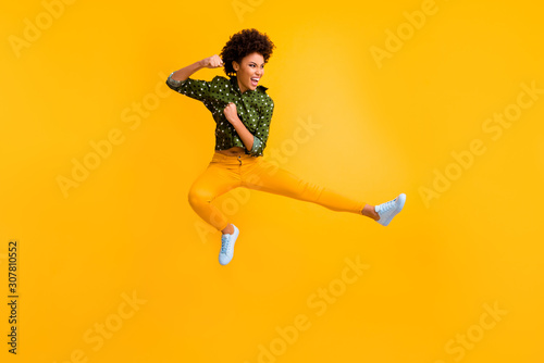 Full length photo of crazy dark skin curly lady jumping high making fighting mov Canvas Print