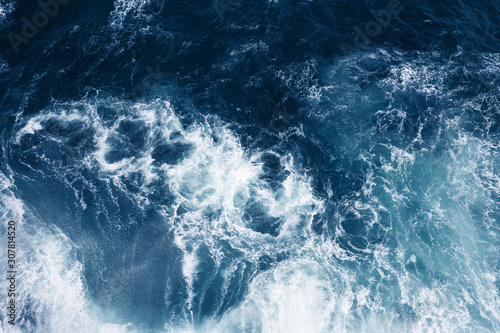 Top view on blue ocean waves.