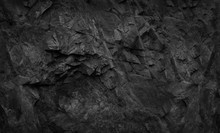 Black Rock Background. Dark Gray Stone Texture. Black Grunge Background. Mountain Close-up.