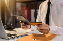 Businessman Use Credit Cards To Conduct Financial Transactions Through Phones, Tablet, And Laptop.