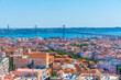 Aerial view of Bridge of 25th April and National sanctuary of Cristo Rei in Lisbon, Portugal