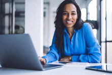 Confident Ethnic Businesswoman...