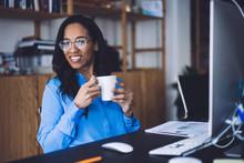 Black Businesswoman Sitting In...