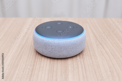 third generation amazon echo dot, white, low view, with blue light on, on a ligh Canvas Print