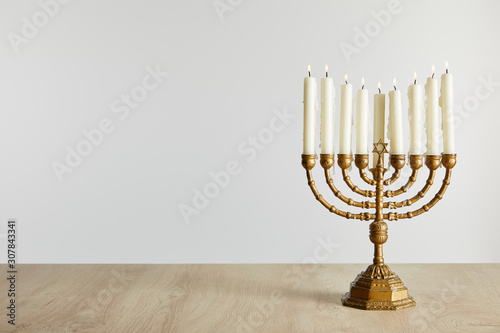 Photo burning candles in menorah on Hanukkah isolated on white