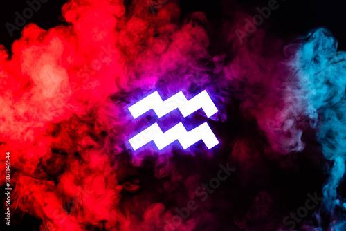 blue illuminated Aquarius zodiac sign with colorful red smoke on background Wallpaper Mural