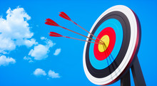 Colored Target Board With Arrows In The Sun Against Blue Sky With Small Clouds - 3D Illustration