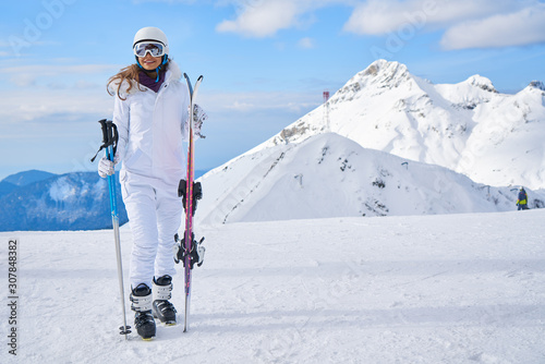 obraz PCV woman skier wearing white healmet with mask in snow winter mountain
