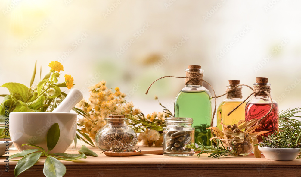 Fototapeta Composition of natural alternative medicine with capsules essence and plants