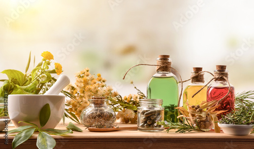 Composition of natural alternative medicine with capsules essence and plants Wallpaper Mural