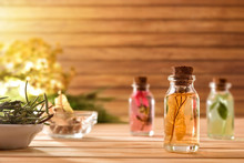 Jars With Plant And Essence In...