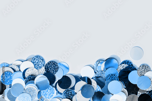 Cuadros en Lienzo Colorful confetti explosion from envelope on blue background.