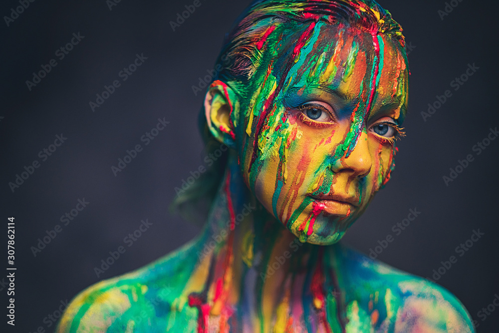 Fototapeta Young woman covered with a colourful paint
