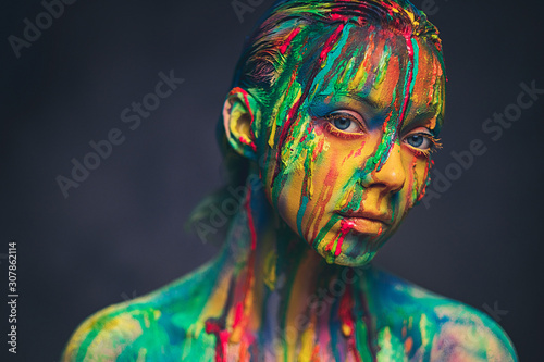 Obraz Young woman covered with a colourful paint - fototapety do salonu