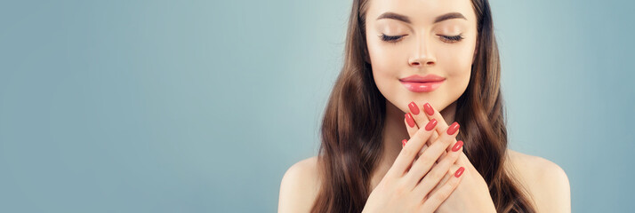 Beautiful model woman with pink manicure nails on blue banner background