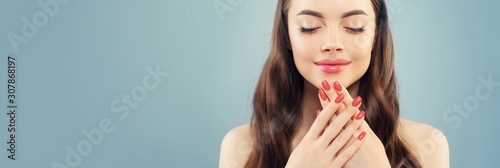 Canvastavla Beautiful model woman with pink manicure nails on blue banner background