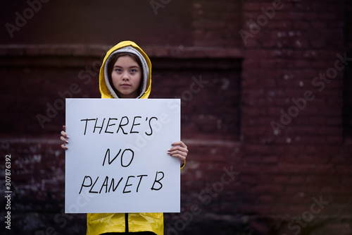 Teenager girl holding placard during global strike for climate change Canvas Print