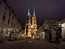 Image Of Wroclaw Cathedral And Christmas Illuminations On Trees At Night
