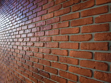 Brown Brick Wall With Shallow Depth Of Field In Horizontal Plane. Selective Focus