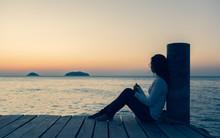 Beautiful Lonely Woman Sitting...