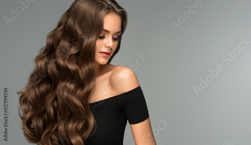 Obraz Beauty brunette girl with long  and   shiny wavy black hair .  Beautiful   woman model with curly hairstyle . - fototapety do salonu