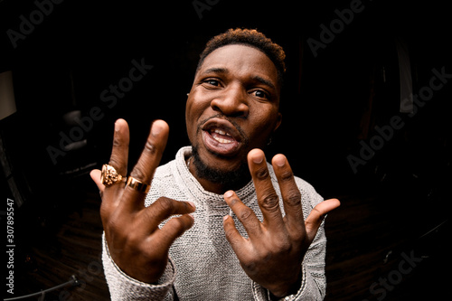 Afro american guy rapping aggressively at camera Canvas Print