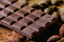 Dark Chocolate Bar With Cocoa Beans, Cocoa Powder. Food Background. Close Up