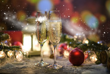 Glasses With Champagne Against The Background Of New Year's Decoration