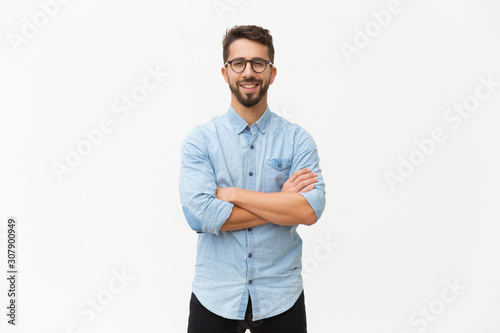 Fototapeta Happy laughing guy posing with arms folded