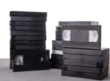 Many VHS Video Cassettes On The Desk With Isolated Background