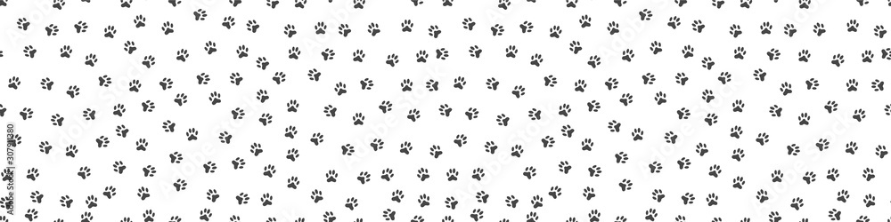 Fototapeta Pet paw print seamless pattern. Abstract animal vector background.