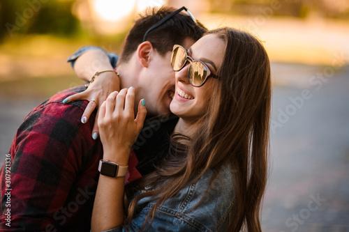 Happy romantic couple hugging in the autumn park Canvas Print