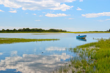 Tranquil View Niantic Connecticut Salt Marsh In Summer With Blue Sky And Blue Boat Reflections Of Cumulus Clouds In Still Water With Copy Space, Saltwater Tidal Marsh, East Lyme, New England Scenic