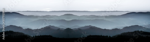 Amazing panorama background banner long from a fog landscape in the morning in black forest