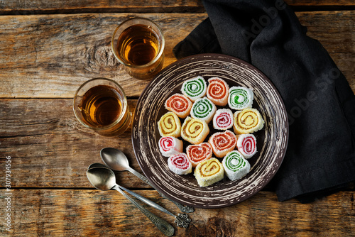 Turkish delight, Oriental sweetness on a plate with tea Wallpaper Mural