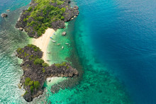 Travel Concept: Tropical Sand Beach And Turquoise Water View From The Top. Lahos Island, Caramoan Islands, Philippines. Summer And Travel Vacation Concept.