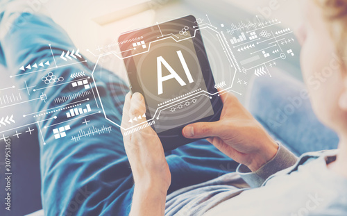 AI concept with man using a tablet in a chair Wallpaper Mural