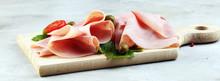 Sliced Ham On Wooden Backgroun...
