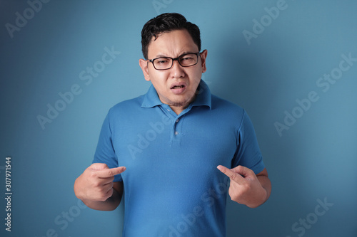 Asian Man Pointing Himself with Unhappy Expression as if he confused to be accus Canvas Print