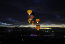 Illuminated Hot Air Balloons At Night
