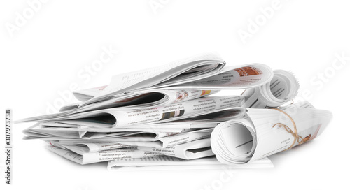 Many newspapers on table against white background Canvas Print