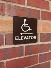 A Handicap Elevator Sign On A ...