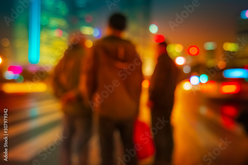 obraz PCV Abstract background of People across the crosswalk at night in Shanghai, China.