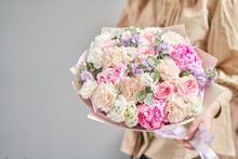 Pink Peonies, Sarah Bernhardt And Different Flowers. European Floral Shop. Beautiful Bouquet In Womans Hands. The Work Of The Florist At A Flower Shop. Delivery Fresh Cut Flower.